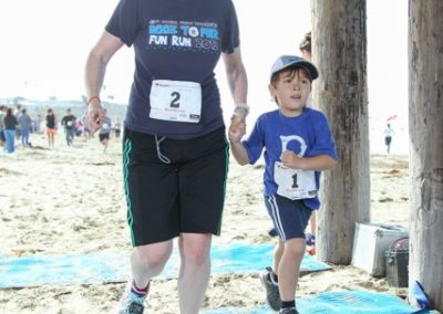 Vikki Waterbury-Phan and son Brian at the finish of the Rock to Pier race named  in memory of her father and his namesake grandfather